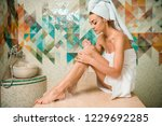 attractive girl applying foam... | Shutterstock . vector #1229692285