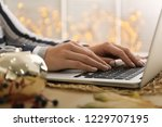 woman using laptop on table ...   Shutterstock . vector #1229707195
