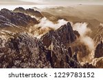 clouds by the mountain peaks of ... | Shutterstock . vector #1229783152