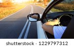 driving a car on empty road on... | Shutterstock . vector #1229797312
