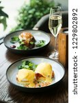 Small photo of Eggs Benedict with salmon