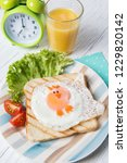 funny toast with fried egg in a ...   Shutterstock . vector #1229820142
