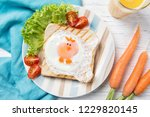funny toast with fried egg in a ...   Shutterstock . vector #1229820145