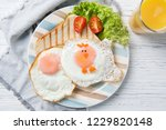 funny toast with fried eggs in...   Shutterstock . vector #1229820148