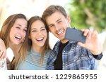 portrait of three happy friends ... | Shutterstock . vector #1229865955