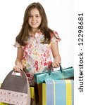Young girl christmas shopping loaded down with bags - stock photo