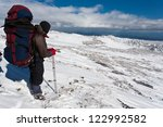 hikers moving in snowy... | Shutterstock . vector #122992582