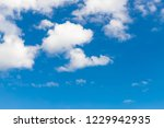 blue sky background and clouds... | Shutterstock . vector #1229942935