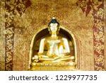 blurred of golden buddha statue ...   Shutterstock . vector #1229977735