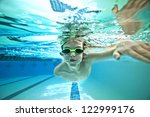 Underwater Shot Of Boy Swimmin...