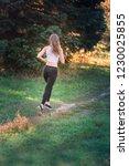 beautiful young sportive woman...   Shutterstock . vector #1230025855