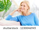 smiling mature female beauty... | Shutterstock . vector #1230046945
