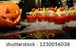 a cocktail of tomato juice in a ... | Shutterstock . vector #1230056038