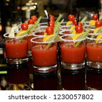 a cocktail of tomato juice in a ... | Shutterstock . vector #1230057802