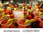 a cocktail of tomato juice in a ... | Shutterstock . vector #1230057805