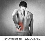 shirtless man touching his back ... | Shutterstock . vector #123005782