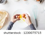 a woman prepares the dough for... | Shutterstock . vector #1230075715