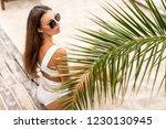 girl on a tropical beach in... | Shutterstock . vector #1230130945