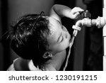 1 year old asian boy drinking... | Shutterstock . vector #1230191215