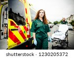 paramedics rolling the... | Shutterstock . vector #1230205372