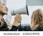 female activist shouting on a... | Shutterstock . vector #1230219955