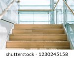 Wooden Staircase Inside Glass...