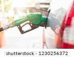 grey car at gas station being... | Shutterstock . vector #1230256372
