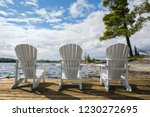 three chairs sitting on a wood... | Shutterstock . vector #1230272695