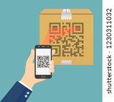 hand holding mobile phone... | Shutterstock .eps vector #1230311032