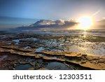 Sunrise On Rocky Beach  ...