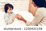 mother giving medicine to sick... | Shutterstock . vector #1230431158