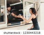 girl in black dress buying... | Shutterstock . vector #1230443218