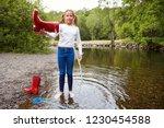 teenage girl standing in a...   Shutterstock . vector #1230454588