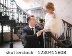 bride and groom are standing on ...   Shutterstock . vector #1230455608