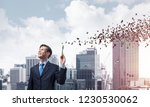 happy and young businessman in...   Shutterstock . vector #1230530062