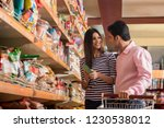 young couple shopping in... | Shutterstock . vector #1230538012