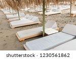 umbrellas and sunbeds on a...   Shutterstock . vector #1230561862