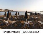 umbrellas and sunbeds on a...   Shutterstock . vector #1230561865