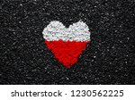 Stock photo flag of poland polish flag heart on the black background stones gravel and shingle wallpaper 1230562225