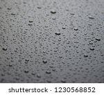raindrops on the car's matte... | Shutterstock . vector #1230568852