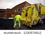 loading garbage in the garbage... | Shutterstock . vector #1230574012