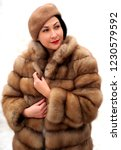 fashion woman in a fur coat.... | Shutterstock . vector #1230579592