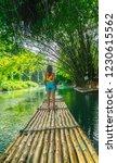 girl standing on bamboo raft...   Shutterstock . vector #1230615562