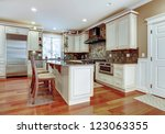 Stock photo large white luxury kitchen with cherry hardwood and stone tiles 123063355