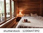 rustic interior of log cabin... | Shutterstock . vector #1230647392