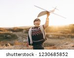 happy boy playing with airplane ... | Shutterstock . vector #1230685852
