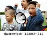 young boy shouting on a... | Shutterstock . vector #1230694312
