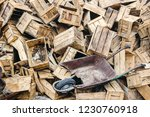 a pile of old wooden boxes  | Shutterstock . vector #1230760918