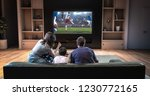 a family is watching a soccer... | Shutterstock . vector #1230772165