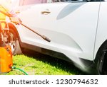 manual car wash with pressure... | Shutterstock . vector #1230794632